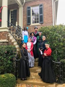 group of people dressed for the holidays on the Gorgas House stairs
